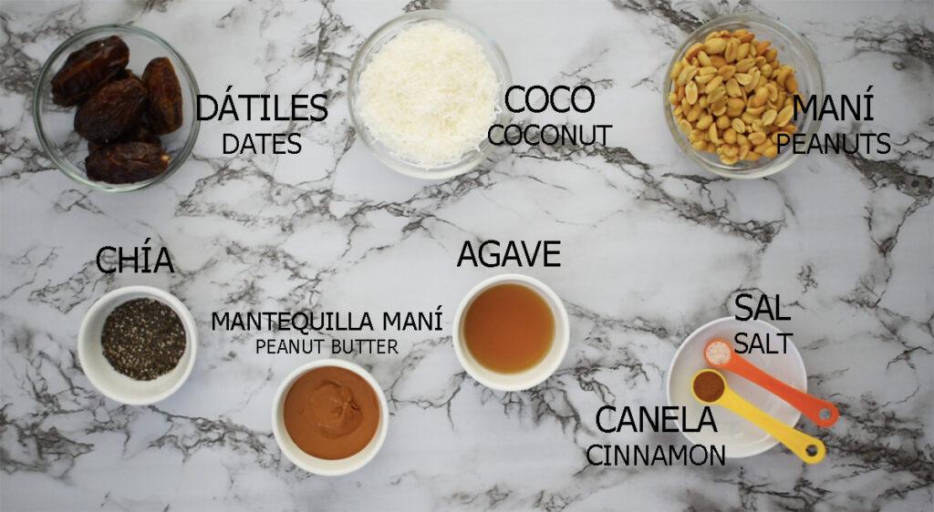 ingredientes necesarios para preparar bolitas energéticas. Dátiles, maní, coco, chía, agave, mantequilla de maní, sal y canela.