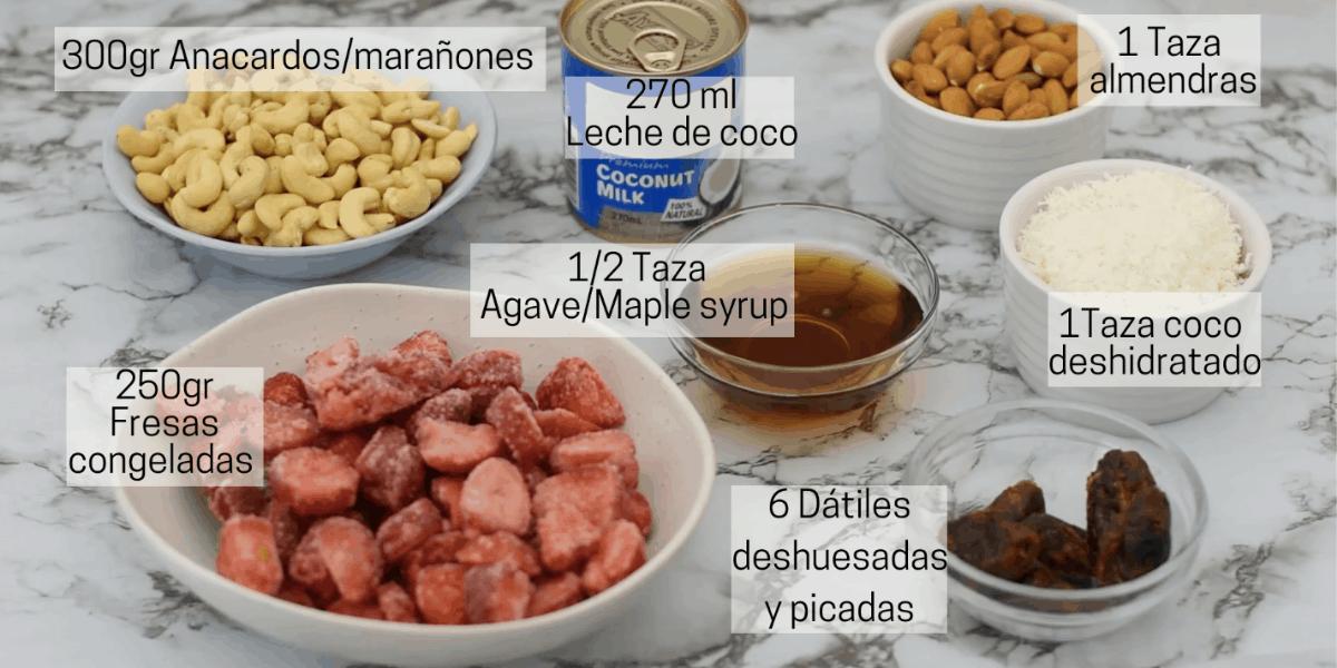 Ingredientes para preparar cheesecake vegano de fresa. Nueces de la india, leche de coco, almendras, maple syrup, coco deshidratado, fresas, dátiles.